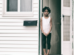 Flint Michigan-Child Waiting For Water. Image by Foster Garvin