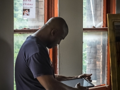 Terrance Blount Reads From His iPad At The July CAAAP Meeting -  Image by Michael Bracey